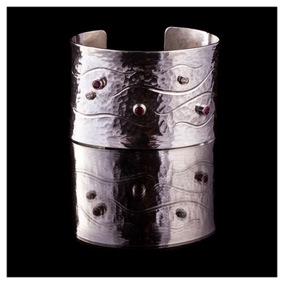 Silver cuff set with rubies and diamonds